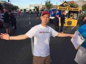 Jeff Pishney, Founder of Love Our Cities, stands wearing a Love Modesto white t-shirt.