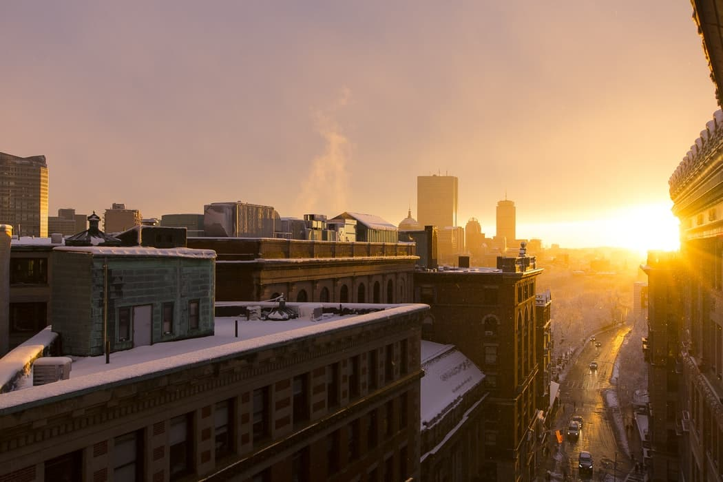 View of a sunrise from a city rooftop.