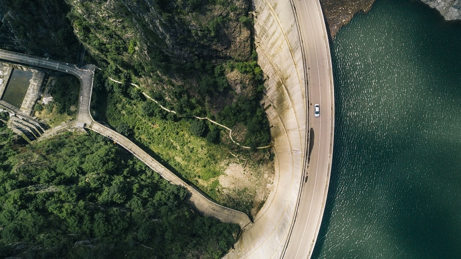 Overhead shot of a road and water way.