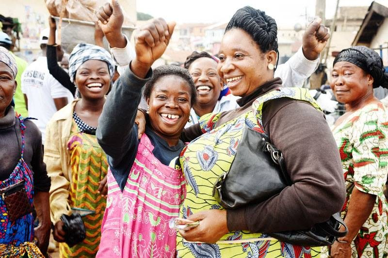 African women celebrating and smiling together.