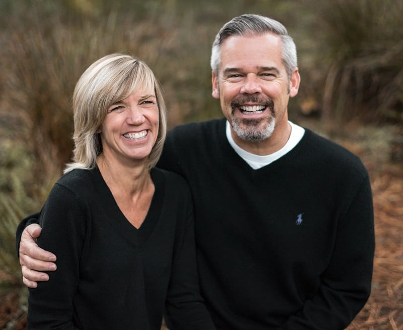 Steve and Patti Buss portrait. Both wearing black shirts.