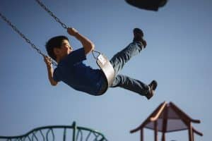 boy on swing set